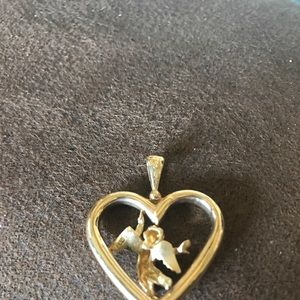 Jewelry - 14 carat gold heart with angel in middle.